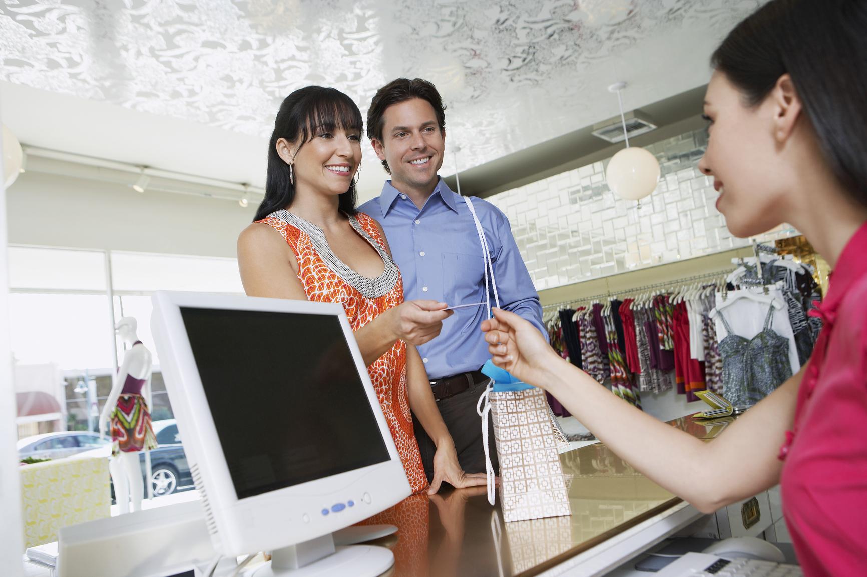 Couple Paying Through Debit Card